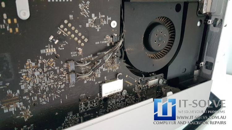 A clogged fan on iMac with a white screen problem