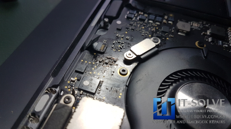 Macbook Water spillage repair - Repairing damaged traces