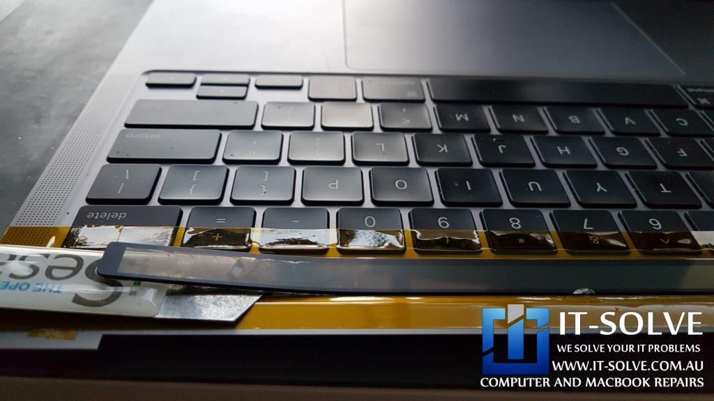 Separating faulty Macbook Touchbar in Macbook Pro Cracked Touchbar Repair process