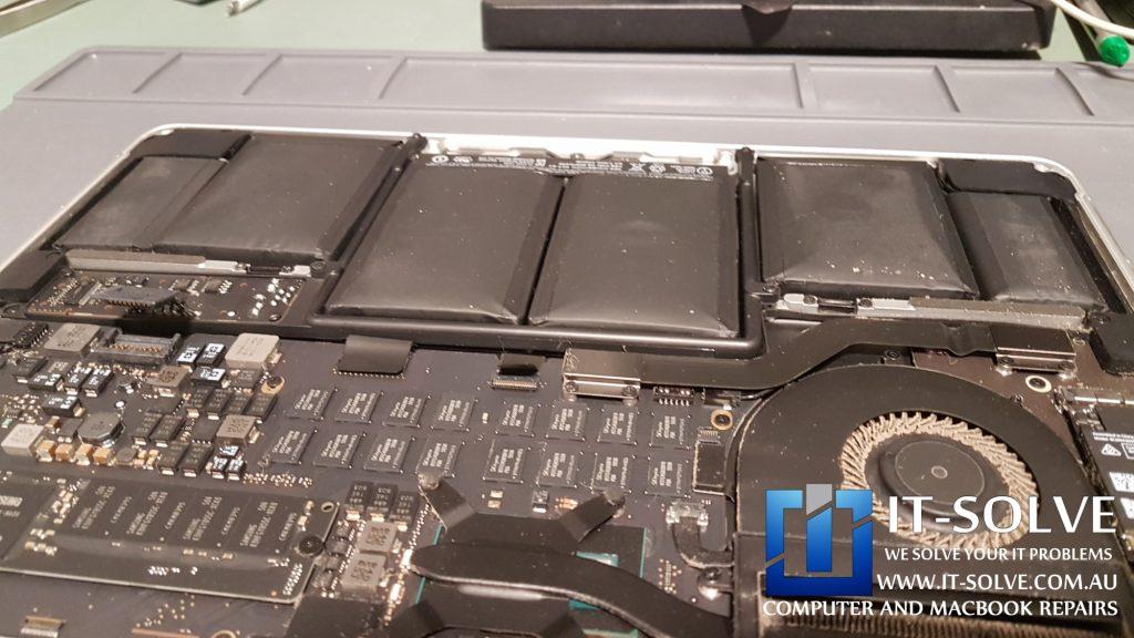 Macbook Battery cells expanded due to heat exposure in overheating Macbook Pro