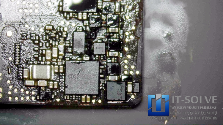 Re-soldering traces and replacing corroded components on Macbook Air A1932