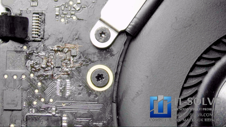 Oxidised and destroyed traces for the charging chip of Macbook A1708