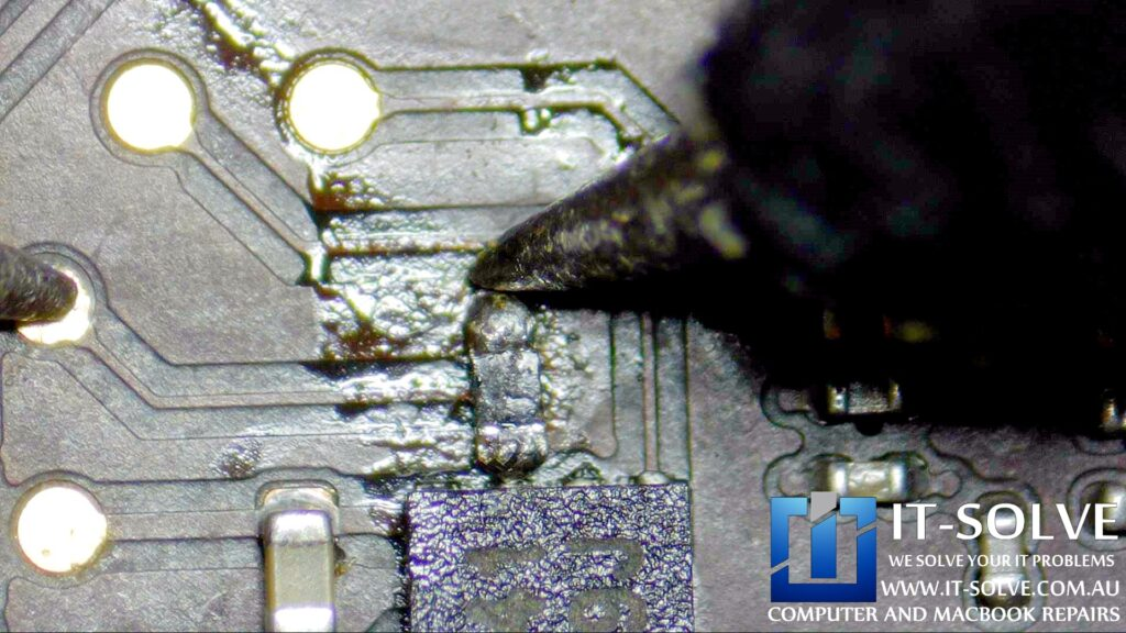 """Measurement of the repaired pads and replacement resistor on water damaged 15"""" Macbook Pro"""